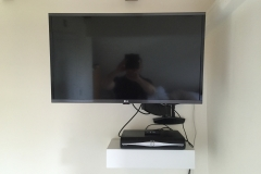 Flat screen TV mounting and remote draw unit